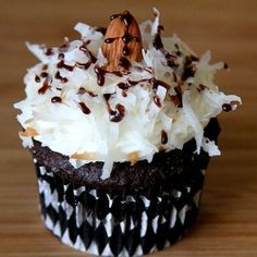Almond Joy Cupcakes: Chocolate cupcakes with creamy, gooey coconut filing, coconut frosting and an almond