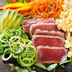 This recipe for ahi tuna salad is seared ahi on a bed of mixed greens with cucumber and carrot noodles, bell peppers, avocado and wontons, all tossed in a sesame ginger dressing. #BBSuperFresh #Seafoodies