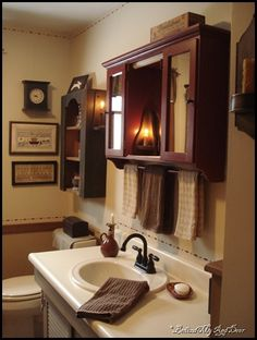 Primitive bathrooms 230950287115255842 - Behind My Red Door: Kitchen, bathroom and life changes…love the medicine cabinet w/towel bar Source by Decor, Bathroom Furniture, Country Decor, Rustic Bathroom Furniture, Bathroom Red, Home Decor, Primitive Decorating Country, Bathrooms Remodel, Bathroom Decor