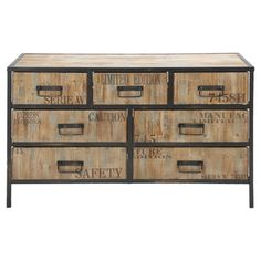 Lend a touch of industrial-chic appeal to your master suite or den with this handsome dresser, showcasing stamped drawer fronts and an iron frame.