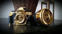 brikk 'lux nikon DF' camera and nikkor 14-24 f/2.8 lens covered in pure 24k yellow gold and also comes with a premium custom case