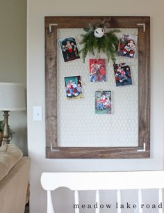 A DIY display board made from pine boards and chicken wire to display a collection of your kids' Santa photos | Meadow Lake Road