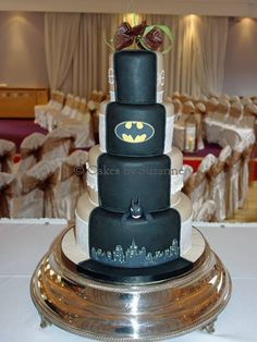 Half traditional, half batman wedding cake