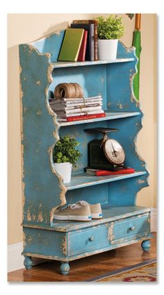 Love this chippy teal shelf for organization:  crafts or sewing room.