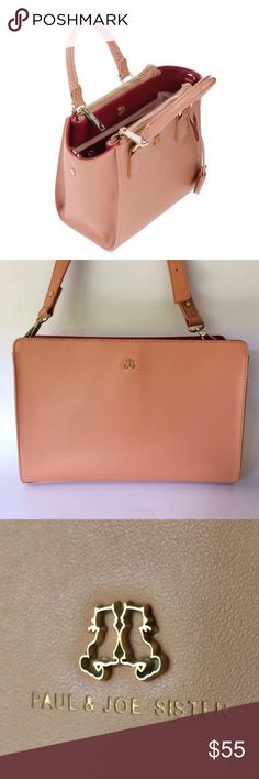 Paul and Joe Sister Crossbody bag In a nice coral pink with a reversible color on the handles in great condition with signs of wear on the back and bottom inside is clean with some marks and space for pencil holders and card slots signs of wear inside 0167814567 Paul & Joe Bags Crossbody Bags