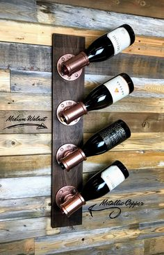 This unique custom wine rack is made of industrial iron pipe fittings using premium select walnut and cherry woods for the base. Best Picture For DIY Wine Rack over refrigerator For Your Taste You are Wine Rack Design, Wood Wine Racks, Diy Wine Racks, Unique Wine Racks, Wine Rack Wall, Pallet Wine Racks, Iron Wine Rack, Wood Rack, Creation Deco