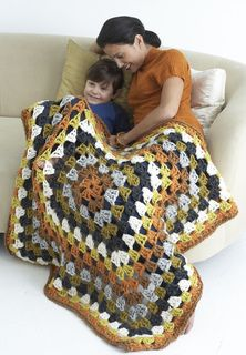 This giant granny square is great to cuddle under. (Lion Brand Yarn)