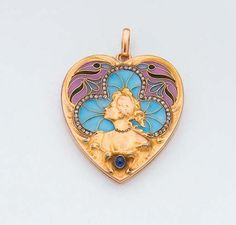 AN ART NOUVEAU ENAMEL, SAPPHIRE, DIAMOND AND GOLD PHOTO LOCKET PENDANT, circa 1900