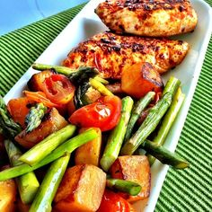 Blackened chicken breast with roasted butternut squash, asparagus and tomatoes Approx macros: 32g protein, 26g carbs, 12g fat (coconut oil)