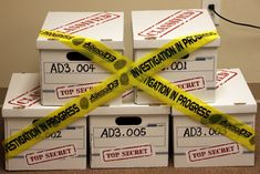Evidence boxes with investigation tape looks good for the evidence vault.
