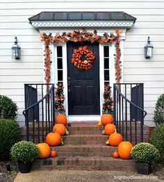 Fall outdoor decorating ideas with pumpkins and seasonal garland