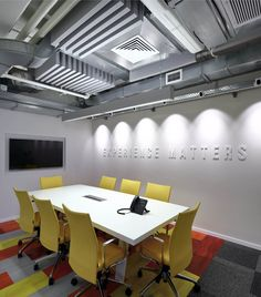 #colorful_meeting_room_design with exposed ceiling.