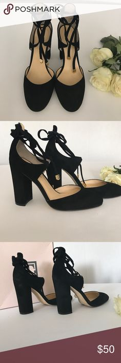 """Ivanka Trump Graffi Pumps in Black Suede Ivanka Trump Graffi Pumps in Black Suede size 7.5,  Laced in a graceful wrapping ankle-tie design, these Graffi pumps from Ivanka Trump add striking elegance that completes your look with on-trend block heel styling. Round-toe lace-up ankle-tie pumps Wrapping ankle tie design 4"""" wrapped block heel Suede upper; manmade sole Ivanka Trump Shoes Heels"""