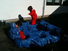 Water play with blue tarp and tyres