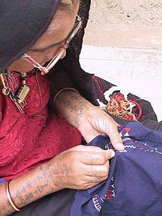 """artisan tapestries from Guatemala.  The patches come from the fabric the women have sewn to make their skirts and """"huipiles"""", which are the traditional hand-woven and embroidered blouses that Mayan women originally began wearing around the time of the Spanish conquest."""