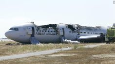 Asiana Airlines Flight 214 sits just off the runway at San Francisco International Airport on Sunday, July 7, in a handout photo from the National Transportation Safety Board. The Boeing 777 coming from Seoul, South Korea, crashed on landing on Saturday, July 6.
