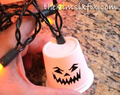 K-Cup Recycled Garland (Ghosts By Day, Pumpkins By Night) via www.TheKimSixFix.com