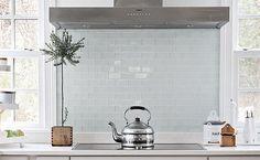 White glass subway tile backsplash. https://www.subwaytileoutlet.com/products/White-Glass-Subway-Tile.html#.VZcdKvlViko