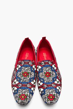 ALEXANDER MCQUEEN // Red Woven Stained Glass Loafers Low top textile loafers in white with woven stained glass pattern throughout in blue, red, green, orange and black. Tonal grosgrain trim at collar, and pull loop at heel collar, in red. Tonal stitching. Textile upper, leather sole. Made in Italy. $925 CAD