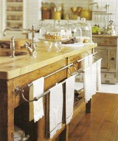 towel rails & cake stands & cloches...<3 the vintage feel in this kitchen