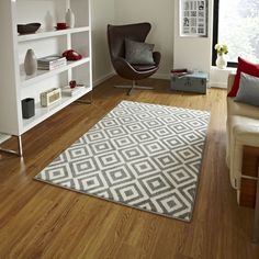 Make a feature of your floor with this statement rug, featuring a bold geometric print. The Verona Grey Rug lends an elegant touch to any room it is placed in, be it your living room, bedroom, dining room or foyer. This area rug is machine woven using 100% polypropylene and stays intact for years. As it is stain resistant, it looks new and does not wear off easily. The rug is durable and should be used with an underlay backing to avoid untoward accidents. As this rug is available in…