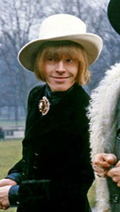 Brian Jones with the Rolling Stones for a photo shoot in Green Park, London England 1967