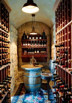 Design by Wiseman and Gale. Wine Cellar. Fonderia pendant by Aldo Bernardi. #lighting #winecellars