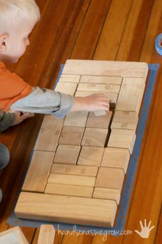 Fill in the taped shape with blocks. Could use poster boards with different shapes for a center.