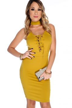 Look sexy in this dress with some some heels! Features; bold color, sleeveless, faux suede, mock neck, deep v-cut lace up, back cut out detailing, above the knee length, finished off with fitted wear. 95% Polyester.