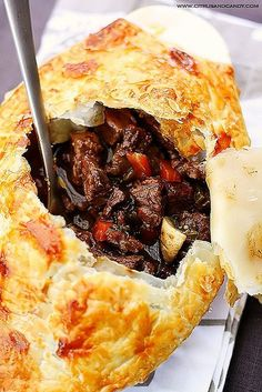 Recipe | Beef & Wine Pot Pie ~ Similar to tying on a sassy French apron, this yummy beef and red wine stew is dressed up in an enticing disguise. Covered over with flaky puff pastry, your slow-simmered Beef Bourguignon is ready for company. ... #meat #main dish #favorite