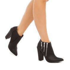 Western with a rebellious side, this MICHAEL ANTONIO pointed-toe bootie is a cool go-to for fall with its zipper accents.