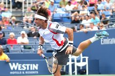 David Ferrer (ESP)[4] in action against Richard Gasquet (FRA)[13] of the US Open. - Billie Weiss/USTA
