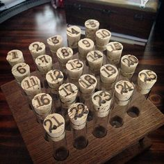 ljcfyi: Woodburned dates on corks for test tube advent calendar.