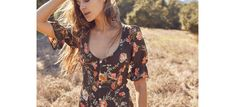   +   The Lennon Dress is both feminine and chic. The dress'sdetails, like itsruffledsleeves and scoop neck are accentuatedby the button-up front. It's hard