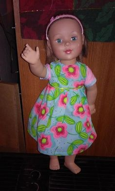 Floral short sleeve dress for 18 inch doll / by tlcgardensandcrafts    Floral Tutti Fruitti fabric in Blue, Pink and Green.