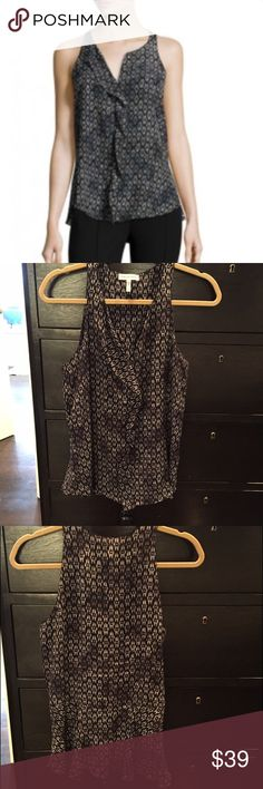 Rebecca Taylor Sleeveless Blouse Black and white print 100% silk blouse from Rebecca Taylor. Size 2. Looks great under a suit, with a skirt, jeans or leather pants. Excellent condition. Ruffle detail on front and bottom hem. Rebecca Taylor Tops Blouses