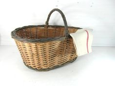 French vintage wicker market basket. Rustic handmade French basket. Superb for storage,display, gardenning, crafts, etc...  In good condition with a certain handmade rustic look, very sturdy  it measures 8.5 high plus 5 handle x 12wide x 18.5 long 21 cm high plus 13 handle x 30 cm wide x 47 cm long For more great French vintage baskets, please click on the link below :  https://www.etsy.com/uk/shop/vintagefrenchdream?section_id=18955808  For more great French vin...