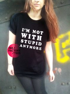 I'm Not With Stupid Anymore T Shirt Black or by ZEEFACTORYTEES, £8.99