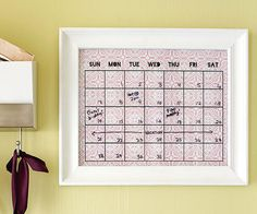 Way better than a whiteboard! Print a monthly calendar onto decorative paper, slap it into a frame, and use a dry-erase marker to keep track of your family's to-dos.