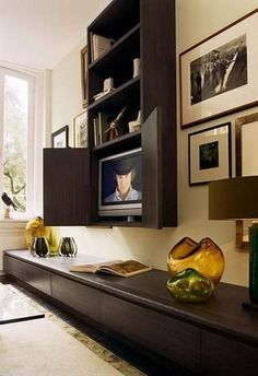Hiding TVs behind hinged and sliding doors or wall decorative panels is one of interior design trends and modern ideas for home staging Tv Escondida, Hidden Tv, Tv Cabinets, Home Staging, Living Room, Living Spaces, Small Spaces, Diy Home Decor, Family Room