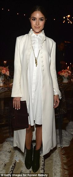 Olivia Culpo rocked a full length ivory coat