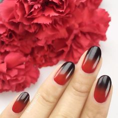 Ditch pretty pastels and go for a vampy gradient manicure instead by pairing dark colors like red and black.