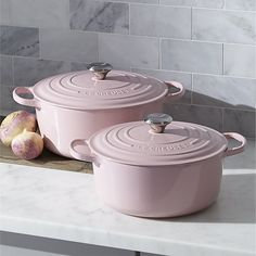 Revered by both professional chefs and home cooks since its 1925 debut, Le Creuset's classic French cookware is prized for its utilitarian good looks and unsurpassed heat retention. This cast-iron French oven is clad in smooth, vitrified porcelain in pastel pink, rendering each piece impervious to acid, alkali, odors and stains. Non-reactive cooking surface does not require seasoning.