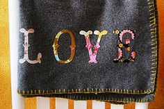 Personalise a cheap fleece blanket...     I'd like to try this.  Looks super cute ;)