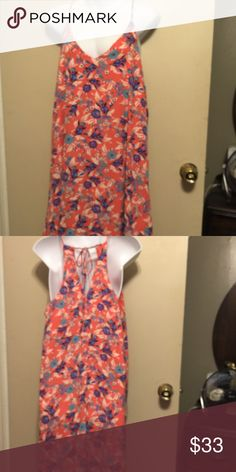 Brigitte Bailey Spaghetti Strap Dress . NWOT Has a V neck in front and a v open back that ties at back of neck . Has lining underneath dress . Shell / lining 100% polyester. Length is 26 inch . brigitte bailey  Dresses Mini