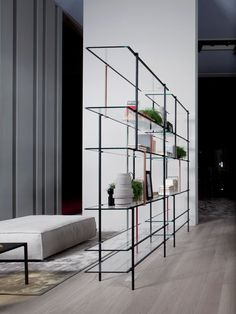 Modern Minimalist Shelving System Assembled of Thin Metal Frames Drizzle
