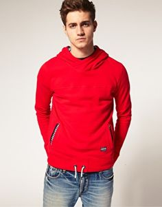 Red hoodie w/ elbow patches.