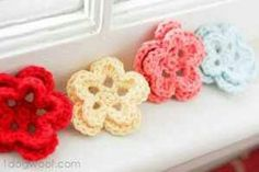 Five-Petal Crocheted Flower- Directions: You'll need:  G size (4.25 mm) crochet hook Small amount of cotton or acrylic worsted weight yarn. Yarn needle Pin or Barrette  Abbreviations, in US terms: ch = chain stitch sc = single crochet sl st = slip stitch hdc = half double crochet stitch dc = double crochet stitch  Magic Ring: Wrap yarn around 2 fingers as if to start with a chain, pull up a loop, but do not tighten. Yarn over, and secure a chain stitch on hook. Work Round 1 stitches into…