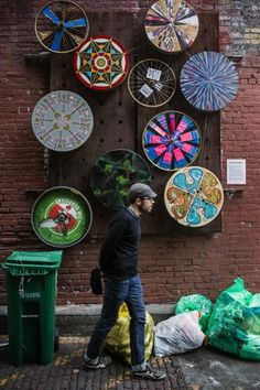 "Eric Dankertson walks by one of five ""Dream Machines"" kinetic sculptures by New Mystics in Nord Alley. The Pioneer Square alley soon will undergo a makeover, with improved pavement and lighting, to make it more pedestrian friendly."
