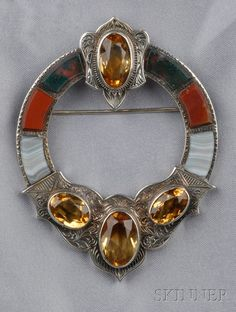 Victorian Sterling Silver, Scottish Agate, and Citrine Brooch, Chester, late 19th century, in the Celtic style, with cushion-shape citrines and various agates and jasper